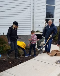 Rev. Hollis and Janet Correia with Sunday School children planting tulips