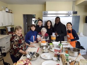 Effie, Rev. Garfield Wu, and Ernest Chambi of Palermo Village Retirement Residence with the Seniors Kitchen Crew