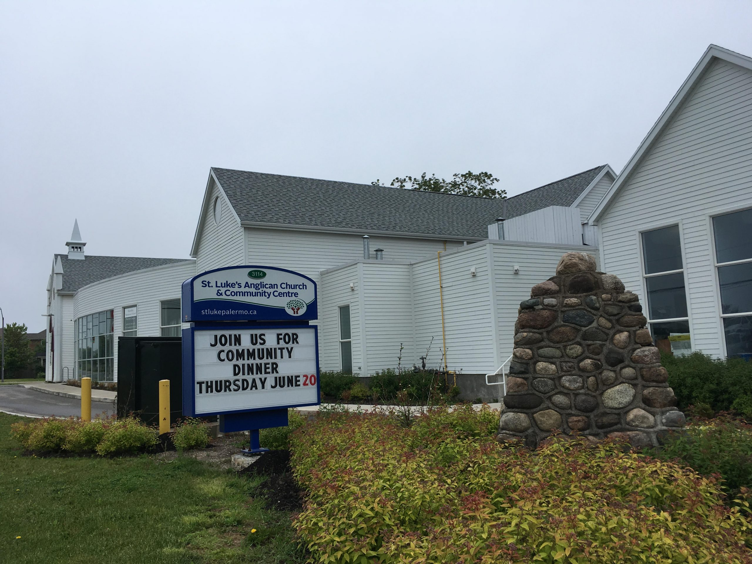 St. Luke's Sign with Cairn