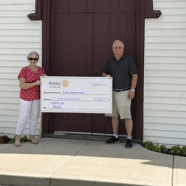 Julie Parks and Rotary Club President Mike Henry