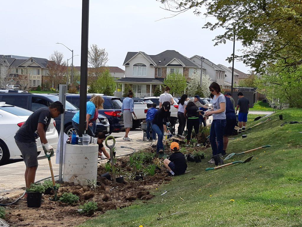 Volunteers and parishioners plant the garden